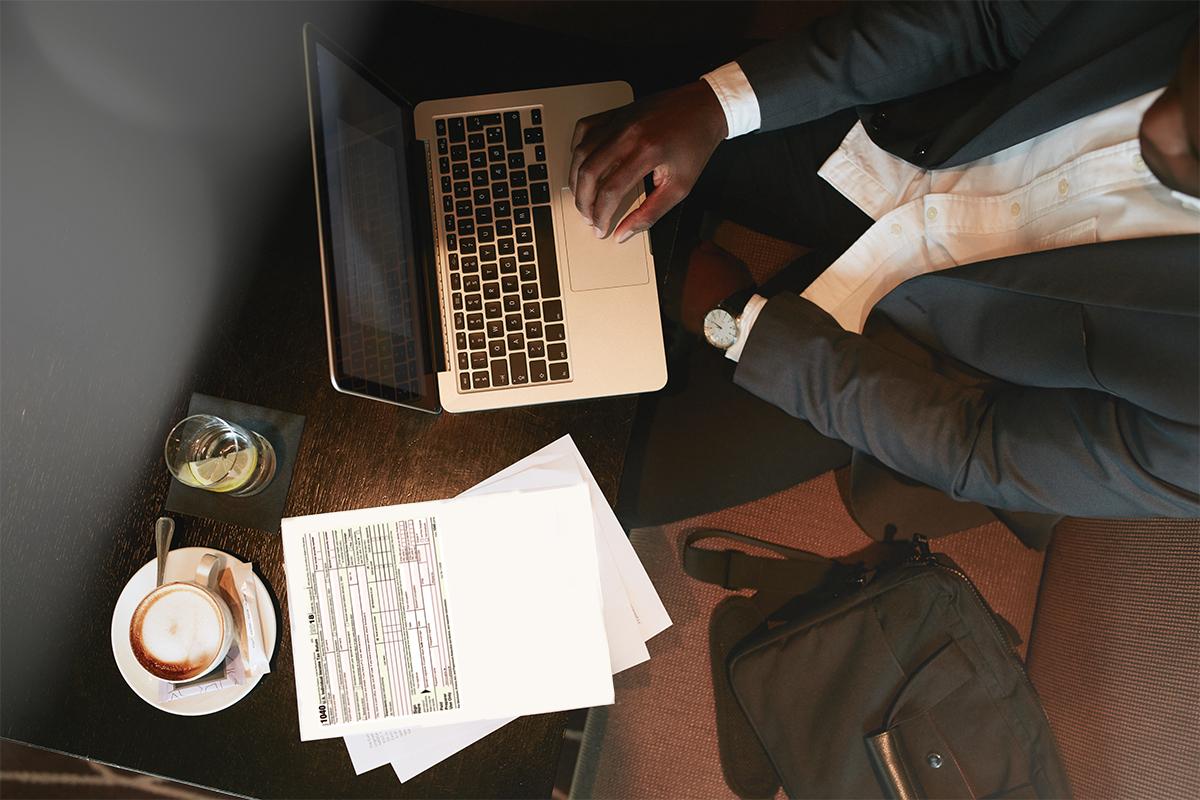 Man doing taxes on laptop