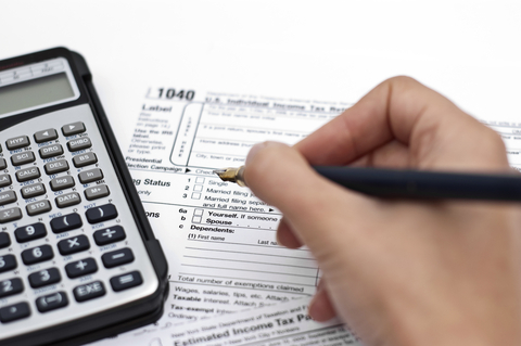 Close-up Filing out Tax Document